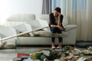 lady in living room after a burglary